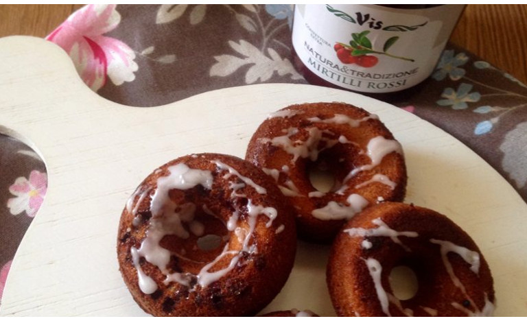 Chocolate donuts with lingonberries jam