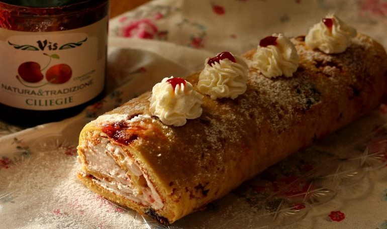 Cake roll with cherry jam and cream